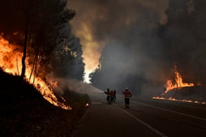 A-dos-Ferreiros, PortugalFirefighters battle flames during a forest fire. Ninety seven seven fire vehicles and two airplanes are working to fight the fire