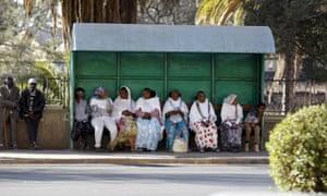 Passangers wait for a bus in Eritrea's capital, Asmara.