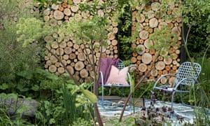 A log wall in Paul Hervey-Brookes' Art of Viking garden.