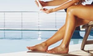 Woman applying sun cream