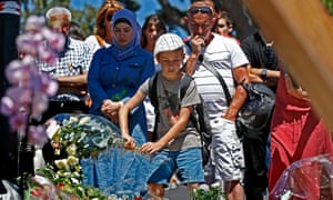 People gather in front of the memorial on the Promenade des Anglais where the truck crashed into the crowd during the Bastille Day celebrations.