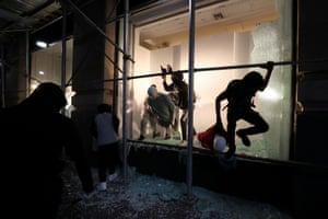 Man jumps out of shop window