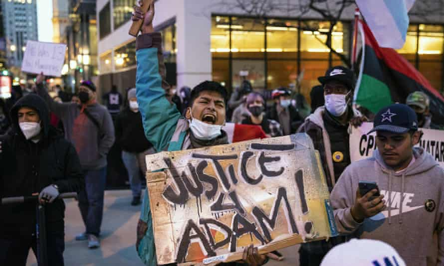 Dozens of protesters march down the Magnificent Mile after the city of Chicago released videos of 13-year-old Adam Toledo being fatally shot by a Chicago police officer, on Thursday evening.