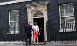 David Cameron walks back into number 10 with his wife Samantha
