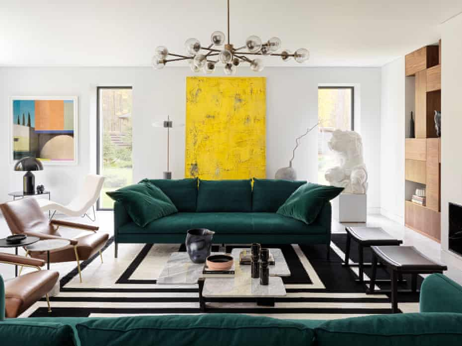 The living room, with a pair of deep sofas in emerald green, by Vincent Van Duysen for Molteni