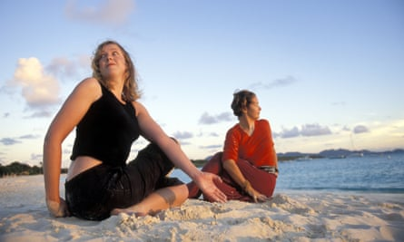 Writer Carole Cadwalladr pratising yoga with Diana Bourel (past-life therapist, inuitive healer, kinespiologist and yoga instructor) at the resort of Cap Juluca on the Caribbean island of Anguilla