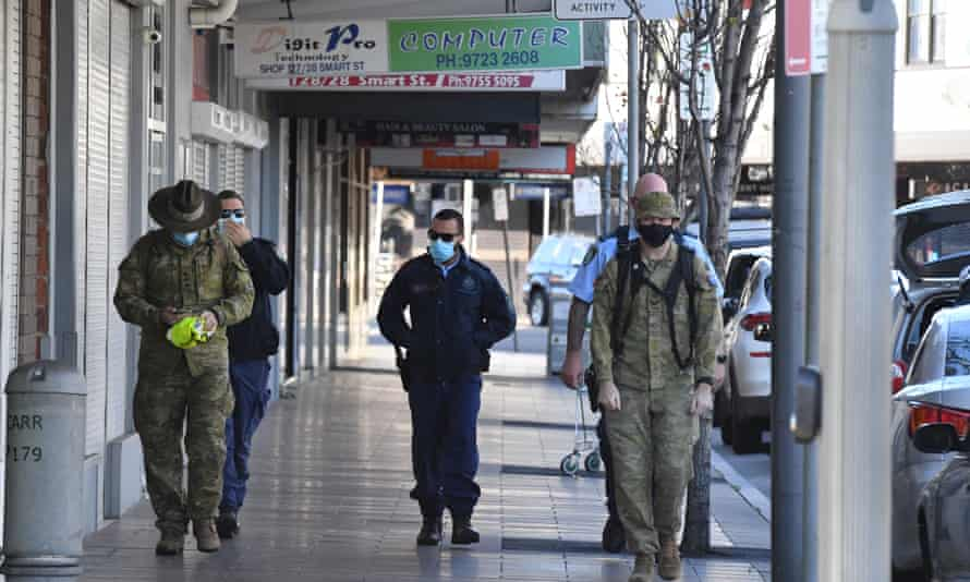 Soldiers and NSW police in Fairfield, south-western Sydney, on Monday morning.