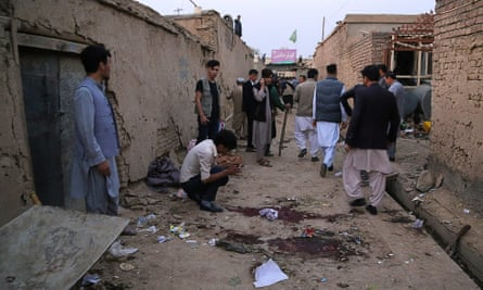Residents gather at a site following a suicide bomb attack in an education centre in Kabul.