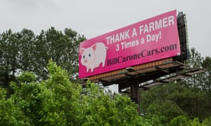 A billboard supporting pig farmers