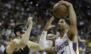 Los Angeles Lakers' Josh Hart shoots around Portland Trail Blazers' Zach Collins