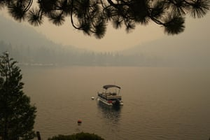 A lone boat on Fallen Leaf Lake, just to the south of Lake Tahoe. An army of firefighters worked to contain the blaze.