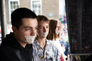 Young protesters tape up their mouths