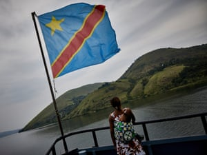A passenger looks at the hills of South Kivu from a boat bound for the city of Bukavu.