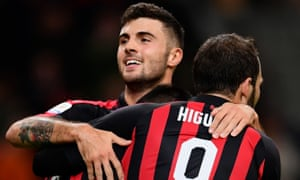 Patrick Cutrone and Gonzalo Higuaín celebrate with Suso (hidden) during the win over Samp.