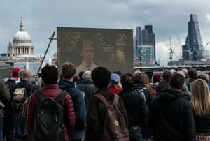 Crowds watch a film of Richard II as part of The Complete Walk, a 2.5-mile stretch of the Southbank in London where 37 screens have been erected, each showing a 10-minute film from Shakespeare's plays
