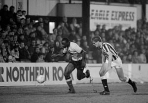 Watford forward Garry Thompson is pursued by Newcastle defender Kevin Scott at Vicarage Road in the third replay.