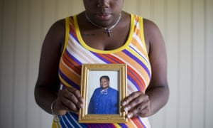 Najee Washington holds a photo of her grandmother Ethel Lance, one of the nine people killed in the shooting at Emanuel AME church.