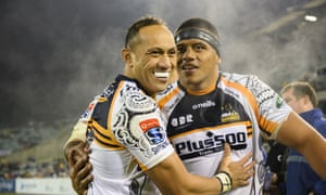 Christian Leali'ifano and Allan Alaalatoa embrace after the Brumbies' win in Canberra