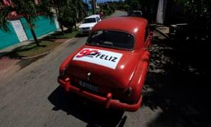 A sticker on a Chevrolet car in Havana, Cuba, saying '90 Happy'.