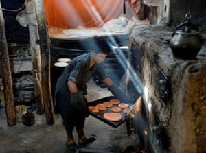 Kabul, Afghanistan A man prepares cookies at a small factory, ready for Eid al-Adha