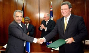 Timor-Leste's Jose Ramos-Horta and Australia's Alexander Downer shake hands after signing the Timor Sea treaty in January 2006