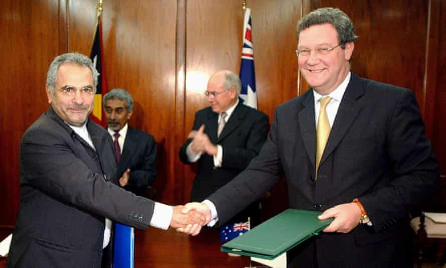 Jose Ramos-Horta and Alexander Downer shake hands after signing the Timor treaty in 2006