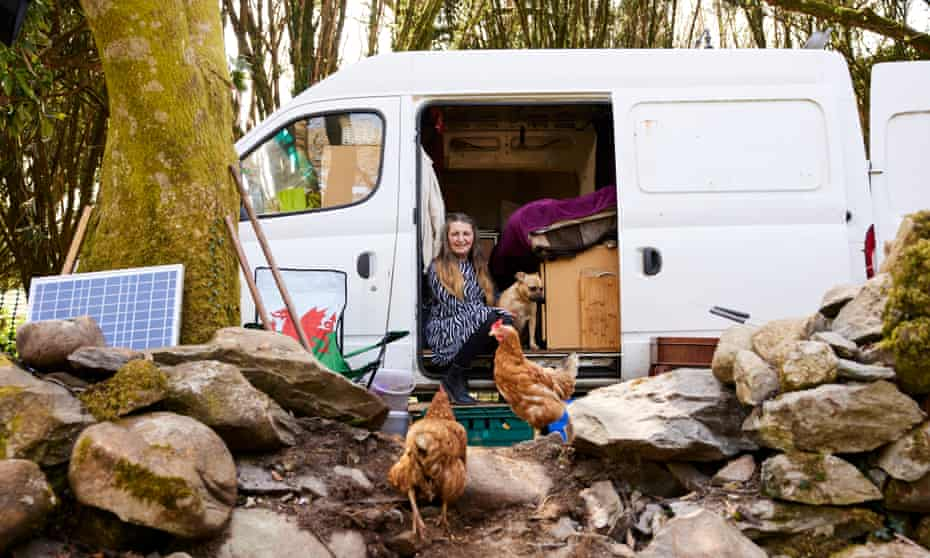 Suzanna Jones, a former truck driver who lives in her van near Caernarfon, Gwynedd, with her dog, cat, hens and a quail.