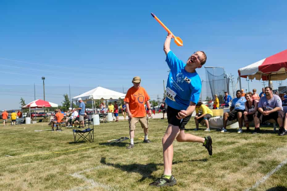 An athlete competes in the mini-javelin event.