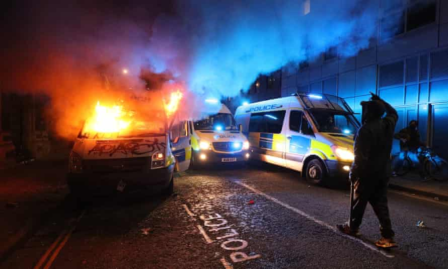 A police van on fire outside Bridewell police station on 21 March