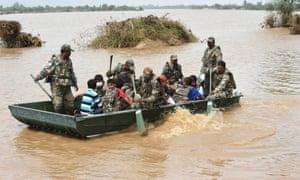 Soldiers rescue stranded flood victims in Khariya village, Gujarat.