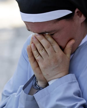 Sister Marjana Lleshi cries during an interview in Ascoli Piceno.