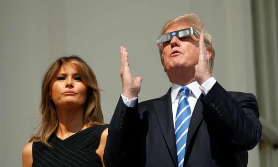 Donald Trump and Melania watch the solar eclipse from the White House in August 2017.