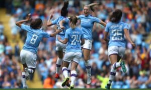 Caroline Weir of Manchester City celebrates scoring the opening goal.