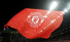 A Manchester United flag is waved before the recent match with Sevilla at Old Trafford.