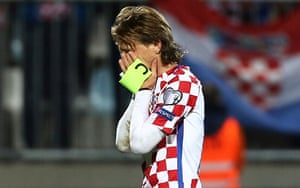 Luka Modric looks dejected after Croatia's 1-1 draw against Finland in their final group game.