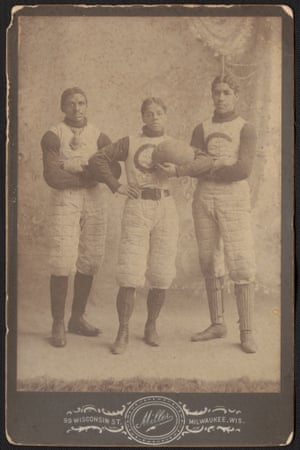 Portrait of three players in uniform holding a ball. The uniforms have a 'c' on the front
