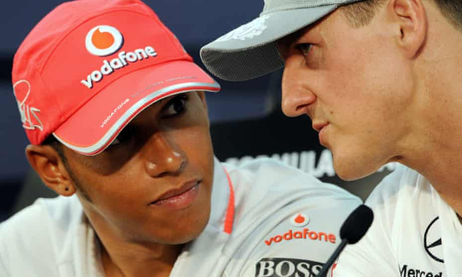 Lewis Hamilton, then with McLaren, chats with Michael Schumacher of Mercedes before the Japanese Grand Prix at Suzuka in October 2010.