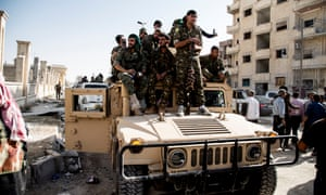 Fighters in the Syrian democratic forces inside Raqqa on 21 October. Kurdish-led forces declared victory in Isis's Syrian 'capital' on Friday.