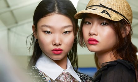 Two models with bright pink lipstick
