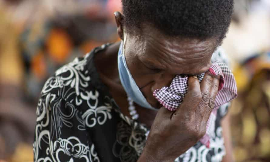 A person in Lukodi listening to the trial on the radio in February of this year.