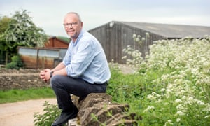 Robert Llewellyn at the barn in Temple Guiting where solar panels are to be installed.