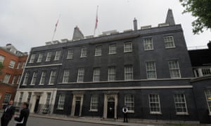 Flags fly at half mast above Downing Street.