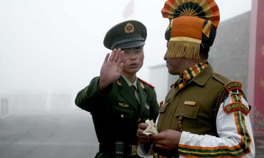 A Chinese and an Indian soldier at the Nathu La border crossing in India's north-eastern Sikkim state in 2008.