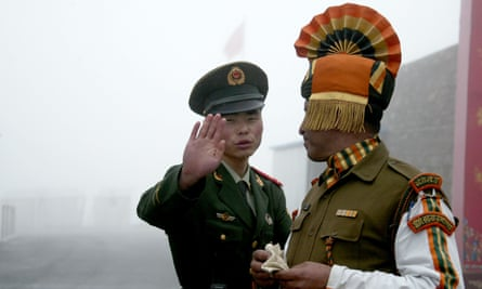 This 2008 image shows a Chinese soldier and an Indian soldier at the Nathu La border crossing.