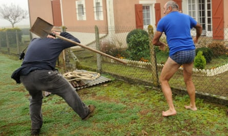 Shove off: the farmer flings his shovel