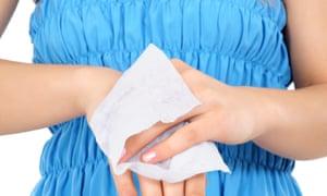 Woman using a wet wipe