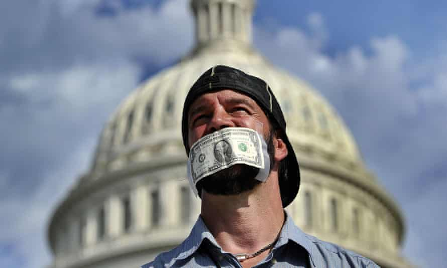 A protester joins a demonstration in front of the US Capitol in Washington, DC, October 2013 urging Congress to pass the budget bill.