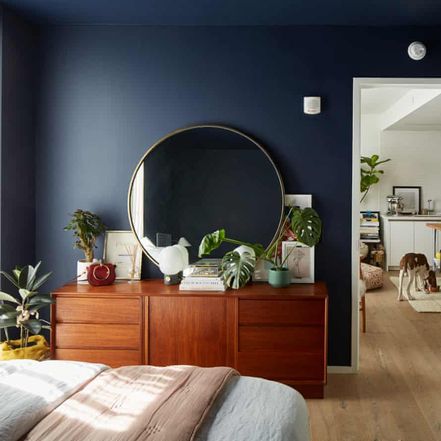 The bedroom, painted deep blue.