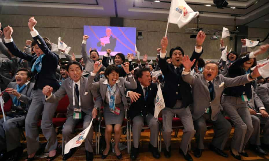 Members of the Tokyo bid committee celebrate in 2013 as the International Olympic Committee announces Tokyo will host the 2020 Games.