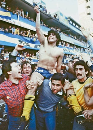 Maradona being carried by fans after winning the 1981 Championship with Boca Juniors at La Bombonera stadium in Buenos Aires